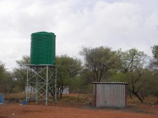 A water tank and borehole had been installed at one of the villages but has been sitting for weeks not operating. Photo: Tom Draper