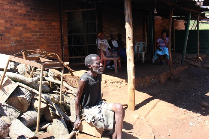 Amon Mthethwa and residents of Hilton College farm sit waiting without work